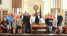 """<div class=""""source"""">Photo by Brandon Mattingly</div><div class=""""image-desc"""">Thomas Riney gathers with family and friends following his commissioning two weeks ago.</div><div class=""""buy-pic""""><a href=""""http://web2.lcni5.com/cgi-bin/c2newbuyphoto.cgi?pub=023&orig=thomas3.jpg"""" target=""""_new"""">Buy this photo</a></div>"""
