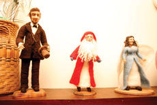 """<div class=""""source"""">Jesse Osbourne</div><div class=""""image-desc"""">Abraham Lincoln and Santa Claus hung out together on the shelf of Norma Jean Campbell's workshop. Campbell's home and workshop will be on display during the Christmas Home Tour on Saturday. </div><div class=""""buy-pic""""><a href=""""http://web2.lcni5.com/cgi-bin/c2newbuyphoto.cgi?pub=023&orig=tour4.jpg"""" target=""""_new"""">Buy this photo</a></div>"""