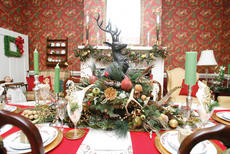 """<div class=""""source"""">Jesse Osbourne</div><div class=""""image-desc"""">A reindeer centerpiece sits on the table in the dining room of the Mayes-Arnold House on Old Perryville Loop. The centerpiece features real pheasant feathers that were recently cured. </div><div class=""""buy-pic""""><a href=""""http://web2.lcni5.com/cgi-bin/c2newbuyphoto.cgi?pub=023&orig=tour5.jpg"""" target=""""_new"""">Buy this photo</a></div>"""