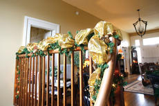 """<div class=""""source"""">Jesse Osbourne</div><div class=""""image-desc"""">The upstairs banister is trimmed with garland in the Mayes-Arnold House.  </div><div class=""""buy-pic""""><a href=""""http://web2.lcni5.com/cgi-bin/c2newbuyphoto.cgi?pub=023&orig=tour6.jpg"""" target=""""_new"""">Buy this photo</a></div>"""