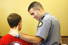 """<div class=""""source"""">Jesse Osbourne</div><div class=""""image-desc"""">State Trooper Aaron Gabhart of Mackville spoke with a Washington County High School freshman during one of the scenarios of the first Truth and Consequences event at the Washington County Judicial Center on Friday. </div><div class=""""buy-pic""""><a href=""""/photo_select/10058"""">Buy this photo</a></div>"""
