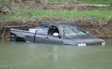 """<div class=""""source"""">Jeff Moreland</div><div class=""""image-desc"""">John Clark's 2000 Chevrolet Silverado was still in the creek off Valley Hill Road Monday afternoon, following Friday's heavy rains and flooding which sent the truck from a nearby bridge. Clark was washed more than a quarter of a mile away from the bridge </div><div class=""""buy-pic""""><a href=""""http://web2.lcni5.com/cgi-bin/c2newbuyphoto.cgi?pub=023&orig=truck-a.jpg"""" target=""""_new"""">Buy this photo</a></div>"""