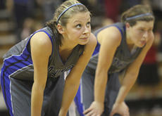 """<div class=""""source"""">Photo by John Overby</div><div class=""""image-desc"""">Senior Amber Grigsby watches as the Cardinals shoot free throws.</div><div class=""""buy-pic""""><a href=""""/photo_select/15456"""">Buy this photo</a></div>"""