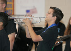 "<div class=""source"">Jeff Moreland</div><div class=""image-desc"">WCHS student Benji Gaona played ""Taps"" as part of the ceremony.</div><div class=""buy-pic""><a href=""/photo_select/378"">Buy this photo</a></div>"