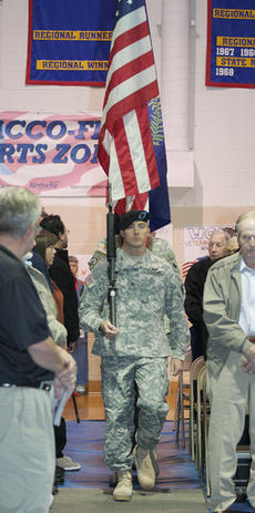 "<div class=""source"">Jeff Moreland</div><div class=""image-desc"">Members of the Springfield National Guard unit served as the color guard, entering the gym with the American and Kentucky flags.</div><div class=""buy-pic""><a href=""/photo_select/375"">Buy this photo</a></div>"