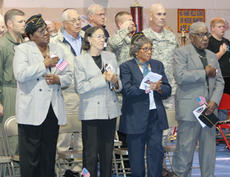 "<div class=""source"">Jeff Moreland</div><div class=""image-desc"">Veterans and honored guests stood and placed their hands on their hearts as the Pledge of Allegiance was recited by Matthew Garrett.</div><div class=""buy-pic""><a href=""/photo_select/376"">Buy this photo</a></div>"