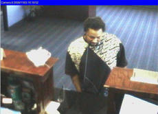 "<div class=""source"">Any</div><div class=""image-desc"">Surveillance video allegedly shows Ledrick Shontay Edwards in banks in the area prior to the Nov. 7 robbery of the branch of Springfield State Bank on Bardstown Road.</div><div class=""buy-pic""><a href=""/photo_select/3588"">Buy this photo</a></div>"