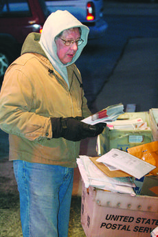 """<div class=""""source"""">Jimmie Earls</div><div class=""""image-desc"""">Postal worker Howard Brady keeps warm as he sorts mail. Brady and others who work outdoors have battled cold temperatures lately as the mercury has dipped near zero.</div><div class=""""buy-pic""""><a href=""""/photo_select/3424"""">Buy this photo</a></div>"""