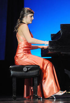 """<div class=""""source"""">Richard RoBards</div><div class=""""image-desc"""">Lauren White, Washington County's Junior Miss 2008, competed in the state Junior Miss contest this past weekend. Here she competes in the talent category.</div><div class=""""buy-pic""""><a href=""""/photo_select/1510"""">Buy this photo</a></div>"""