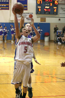 """<div class=""""source"""">Jimmie Earls</div><div class=""""image-desc"""">With Washington County trailing 15-7 in the third quarter, junior Alex Simms drives to the basket against Bardstown in the first round of the 19th District Tournament Wednesday night in Springfield. The Commanders lost to the Tigers, 34-21.</div><div class=""""buy-pic""""><a href=""""/photo_select/2991"""">Buy this photo</a></div>"""