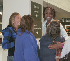 "<div class=""source"">Shorty Lassiter</div><div class=""image-desc"">Ange Umulisa was greeted at Lexington's Bluegrass Airport by her new Commanderette teammates as she arrived in Kentucky back in October.</div><div class=""buy-pic""><a href=""http://web2.lcni5.com/cgi-bin/c2newbuyphoto.cgi?pub=023&orig=web-ange2.jpg"" target=""_new"">Buy this photo</a></div>"