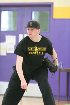 "<div class=""source"">Jimmie Earls</div><div class=""image-desc"">Freshman pitcher Dan Koester watches one of his pitches as the Patriots practice in the gym at Lourdes Hall. </div><div class=""buy-pic""><a href=""/photo_select/920"">Buy this photo</a></div>"