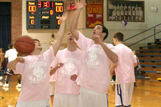 """<div class=""""source"""">Jimmie Earls</div><div class=""""image-desc"""">WC's Steven Sexton, Harrison Simms and John Hamilton warm up before the coaches vs. cancer game Friday night against Marion County.</div><div class=""""buy-pic""""><a href=""""/photo_select/3221"""">Buy this photo</a></div>"""