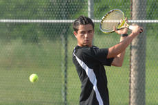 "<div class=""source"">Neal Cardin/Landmark News Service</div><div class=""image-desc"">Washington County sophomore Cyrus Moslemi advanced to the state tournament with impressive wins at the 5th Region tournament in Elizabethtown last week. Moslemi won the regional championship by defeating Central Hardin's Zach Thomas 6-0, 6-0.</div><div class=""buy-pic""><a href=""/photo_select/6551"">Buy this photo</a></div>"