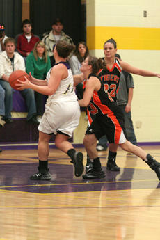 """<div class=""""source"""">Jimmie Earls</div><div class=""""image-desc"""">Georgetown guard Katie Filiatreau, a Washington County High School graduate, guards against St. Catharine's Taylor Oliver (11) in womens hardwood action on Thursday night.</div><div class=""""buy-pic""""><a href=""""/photo_select/6931"""">Buy this photo</a></div>"""