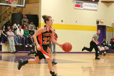 """<div class=""""source"""">Jimmie Earls</div><div class=""""image-desc"""">Lady Tiger Katie Filiatreau brings the ball up court against the St. Catharine Lady Patriots.</div><div class=""""buy-pic""""><a href=""""/photo_select/6930"""">Buy this photo</a></div>"""