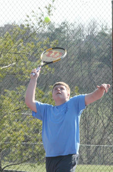 """<div class=""""source"""">Jimmie Earls</div><div class=""""image-desc"""">Bob Grider works on his serve as the Washington County High School tennis team hit the court for practice last Wednesday.</div><div class=""""buy-pic""""><a href=""""http://web2.lcni5.com/cgi-bin/c2newbuyphoto.cgi?pub=023&orig=web-grider.jpg"""" target=""""_new"""">Buy this photo</a></div>"""