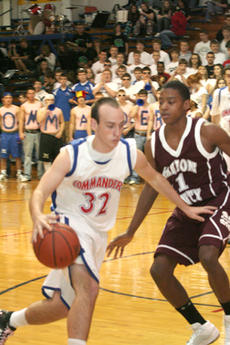 """<div class=""""source"""">Richard RoBards</div><div class=""""image-desc"""">Matthew Hale (32) blocked a shot against Campbellsville in """"All A"""" regional tournament action last week. Campbellsville edged the Commanders 62-59 to advance to the championship game.</div><div class=""""buy-pic""""><a href=""""http://web2.lcni5.com/cgi-bin/c2newbuyphoto.cgi?pub=023&orig=web-hale.jpg"""" target=""""_new"""">Buy this photo</a></div>"""