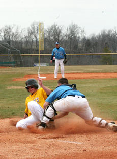 "<div class=""source"">Jimmie Earls</div><div class=""image-desc"">Oakland City catcher John Feltner tags out SCC's Kaleb Henry at the plate in the first game of a doubleheader Thursday.</div><div class=""buy-pic""><a href=""/photo_select/4043"">Buy this photo</a></div>"