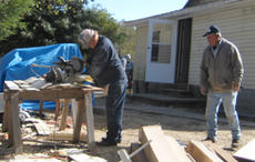 "<div class=""source"">Photo submitted</div><div class=""image-desc"">Springfield Knights of Columbus members Jimmie Carrico, left, and David Smith work on a project to restore a home in Eastern Kentucky.</div><div class=""buy-pic""><a href=""/photo_select/657"">Buy this photo</a></div>"