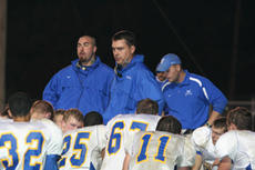 """<div class=""""source"""">Jimmie Earls</div><div class=""""image-desc"""">Washington County's head football coach Mary Perry, center, addresses his team following a 49-48 road loss to Elizabethtown on Oct. 31.</div><div class=""""buy-pic""""><a href=""""/photo_select/6425"""">Buy this photo</a></div>"""