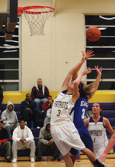 "<div class=""source"">Jimmie Earls</div><div class=""image-desc"">St. Catharine junior guard Erin Rogers (3) fights for a rebound against the Lady Eagles of Alice Lloyd College last Tuesday while teammate Whitney Jordan (1) looks on.</div><div class=""buy-pic""><a href=""/photo_select/5553"">Buy this photo</a></div>"