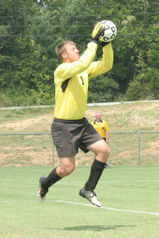 """<div class=""""source"""">Jimmie Earls</div><div class=""""image-desc"""">Patriot goalkeeper William Johnston stops a shot on goal earlier in the season.</div><div class=""""buy-pic""""><a href=""""/photo_select/3993"""">Buy this photo</a></div>"""