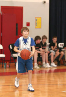 """<div class=""""source"""">Jimmie Earls</div><div class=""""image-desc"""">Will Schlosser takes a shot at the hoop for St. Dominic in middle school tournament action Friday.</div><div class=""""buy-pic""""><a href=""""http://web2.lcni5.com/cgi-bin/c2newbuyphoto.cgi?pub=023&orig=web-schlosser.jpg"""" target=""""_new"""">Buy this photo</a></div>"""