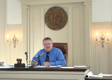 "<div class=""source"">Jimmie Earls</div><div class=""image-desc"">Washington County Judge-Executive John A. Settles presides over a fiscal court meeting held last Friday in the courtroom of the historic 1816 courthouse in Springfield.</div><div class=""buy-pic""><a href=""/photo_select/691"">Buy this photo</a></div>"