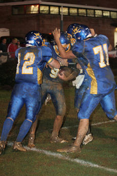 """<div class=""""source"""">Jimmie Earls</div><div class=""""image-desc"""">Washington County senior quarterback Michael Gash (12) and senior center Hunter Goatley (71) celebrate with junior receiver Ben Simms, center, who just scored his second touchdown of the game to put the Commanders ahead 21-0 over Fort Knox, on their way t</div><div class=""""buy-pic""""><a href=""""http://web2.lcni5.com/cgi-bin/c2newbuyphoto.cgi?pub=023&orig=web-simms.jpg"""" target=""""_new"""">Buy this photo</a></div>"""