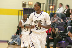 """<div class=""""source"""">Jimmie Earls</div><div class=""""image-desc"""">St. Catharine sophomore Peter Uwamahoro may have a tough time on the hardwood, but it doesn't compare to the struggles he went through in Rwanda.</div><div class=""""buy-pic""""><a href=""""http://web2.lcni5.com/cgi-bin/c2newbuyphoto.cgi?pub=023&orig=web-uwamahoro.jpg"""" target=""""_new"""">Buy this photo</a></div>"""