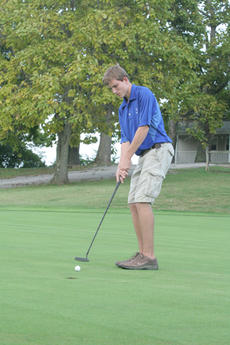 """<div class=""""source"""">Jimmie Earls</div><div class=""""image-desc"""">Junior Jared Kelty aims for the cup as Washington County hosted Anderson County and Burgin in boys' golf match play last week.</div><div class=""""buy-pic""""><a href=""""http://web2.lcni5.com/cgi-bin/c2newbuyphoto.cgi?pub=023&orig=web-wcgolf-kelty.jpg"""" target=""""_new"""">Buy this photo</a></div>"""