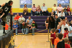 "<div class=""source"">Jimmie Earls</div><div class=""image-desc"">Wrestler Scott Cardinal, left, deals with some heckling kids during an Ohio Valley Wrestling event at St. Catharine College Friday evening.</div><div class=""buy-pic""><a href=""/photo_select/5147"">Buy this photo</a></div>"