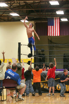 "<div class=""source"">Jimmie Earls</div><div class=""image-desc"">Wrestler Fang salutes the crowd after defeating Karl ""Twinkletoes"" Martin at St. Catharine College on Friday.</div><div class=""buy-pic""><a href=""/photo_select/5146"">Buy this photo</a></div>"