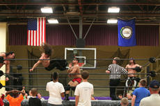 "<div class=""source"">Jimmie Earls</div><div class=""image-desc"">Wrestler Sucio flies through the air toward Jamin Olivencia in tag team action as Ohio Valley Wrestling visited St. Catharine College to help raise funds for the soccer program.</div><div class=""buy-pic""><a href=""/photo_select/5148"">Buy this photo</a></div>"