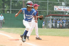 """<div class=""""source"""">Jimmie Earls</div><div class=""""image-desc"""">WC pinch-runner Zana Yocum takes a lead off third base after a pitch crosses the plate in recent softball action.</div><div class=""""buy-pic""""><a href=""""/photo_select/4964"""">Buy this photo</a></div>"""
