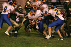 """<div class=""""source"""">Jimmie Earls</div><div class=""""image-desc"""">Washington County freshmen Patrick Warner (8) and Connor Riney (23) open up a running lane for junior quarterback Michael Gash, center. Younger players got some experience this season that they will put to use in 2009.</div><div class=""""buy-pic""""><a href=""""/photo_select/6427"""">Buy this photo</a></div>"""