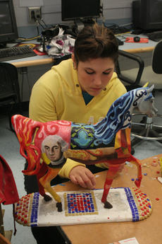 "<div class=""source"">Jimmie Earls</div><div class=""image-desc"">Washington County High School senior Laura Turner works on a mosaic section of her untitled piece which will be on display during the Alltech FEI World Equestrian Games. Her inspiration was the Arabian horse which George Washington rode.</div><div class=""buy-pic""><a href=""http://web2.lcni5.com/cgi-bin/c2newbuyphoto.cgi?pub=023&orig=web_20100414_alltech_horses_laura_turner.jpg"" target=""_new"">Buy this photo</a></div>"