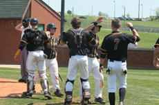 """<div class=""""source"""">Jimmie Earls</div><div class=""""image-desc"""">SCC's Tyler Mischel, second from left, and Ryan Mangione, second from right, return to a spirited Patriot dugout after scoring against the University of the Cumberlands on Friday. The Bat Pats won the series in two games to advance to the Mid-South Confer</div><div class=""""buy-pic""""><a href=""""/photo_select/4093"""">Buy this photo</a></div>"""