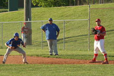 """<div class=""""source"""">Jimmie Earls</div><div class=""""image-desc"""">Commander sophomore pinch-runner Connor Riney takes a big lead off first base in a 7-2 Washington County loss to Mercer County Thursday evening.</div><div class=""""buy-pic""""><a href=""""/photo_select/5898"""">Buy this photo</a></div>"""