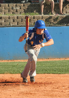 """<div class=""""source"""">Jimmie Earls</div><div class=""""image-desc"""">Washington County senior third baseman Fergus McCain lays down a sacrifice bunt to move a runner into scoring position against Mercer County. WC lost the game, 7-2.</div><div class=""""buy-pic""""><a href=""""/photo_select/5896"""">Buy this photo</a></div>"""