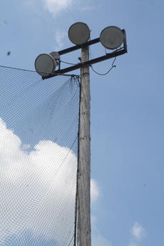"<div class=""source"">Jimmie Earls</div><div class=""image-desc"">The city of Springfield is looking into rewiring the light poles on the Little League fields at Idle Hour Park.</div><div class=""buy-pic""><a href=""http://web2.lcni5.com/cgi-bin/c2newbuyphoto.cgi?pub=023&orig=web_20100721_park_lights.jpg"" target=""_new"">Buy this photo</a></div>"