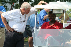 """<div class=""""source"""">Jimmie Earls</div><div class=""""image-desc"""">St. Catharine College President William Huston talks to former UK basketball player Walter McCarty during last year's SCC Celebrity Golf Classic.</div><div class=""""buy-pic""""><a href=""""/photo_select/5301"""">Buy this photo</a></div>"""