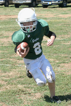 "<div class=""source"">Jimmie Earls</div><div class=""image-desc"">Jacob Yates of the Eagles carries the ball in opening weekend of the Blake Hoppes Football League. This league, as well as the St. Dominic middle school football team, uses the field located behind the Washington County Board of Education. Work on the fie</div><div class=""buy-pic""><a href=""/photo_select/4523"">Buy this photo</a></div>"