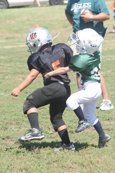 "<div class=""source"">Jimmie Earls</div><div class=""image-desc"">Eagles defender Billy Cermola, right, tries to tackle the Bengals' Michael Ellery in Blake Hoppes youth football action on Sunday.</div><div class=""buy-pic""><a href=""/photo_select/4522"">Buy this photo</a></div>"