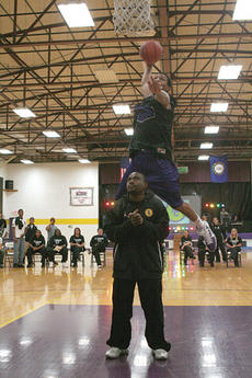 """<div class=""""source""""></div><div class=""""image-desc"""">St. Catharine sophomore Justin Morris takes flight to win the slam dunk contest as part of Patriot Madness last week on the campus of St. Catharine College. </div><div class=""""buy-pic""""><a href=""""/photo_select/7012"""">Buy this photo</a></div>"""