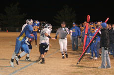 """<div class=""""source"""">Photo by Jimmie Earls</div><div class=""""image-desc"""">On fourth-and-21 on the Falcon 41-yard line, Commander senior Ben Simms keeps both feet in bounds while making a catch for a first down to keep the WC drive alive in the final minutes of the game.</div><div class=""""buy-pic""""><a href=""""/photo_select/7224"""">Buy this photo</a></div>"""