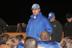 """<div class=""""source"""">Photo by Jimmie Earls</div><div class=""""image-desc"""">A somber Mark Perry talks to his team following a one-point loss to Monroe County Friday night in playoff action.</div><div class=""""buy-pic""""><a href=""""/photo_select/7227"""">Buy this photo</a></div>"""