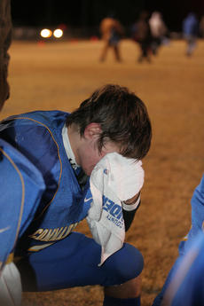 """<div class=""""source"""">Photo by Jimmie Earls</div><div class=""""image-desc"""">A winning season that is now over is too much for Washington County quarterback Trae Abell following a 36-35 loss to Monroe County Friday night.</div><div class=""""buy-pic""""><a href=""""/photo_select/7226"""">Buy this photo</a></div>"""