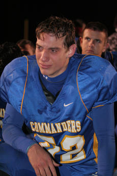 """<div class=""""source"""">Photo by Jimmie Earls</div><div class=""""image-desc"""">Following an emotion-packed 36-35 loss to Monroe County in playoff action Friday night, Tyler Coulter and several other Commanders broke down as their season came to an end. </div><div class=""""buy-pic""""><a href=""""/photo_select/7223"""">Buy this photo</a></div>"""